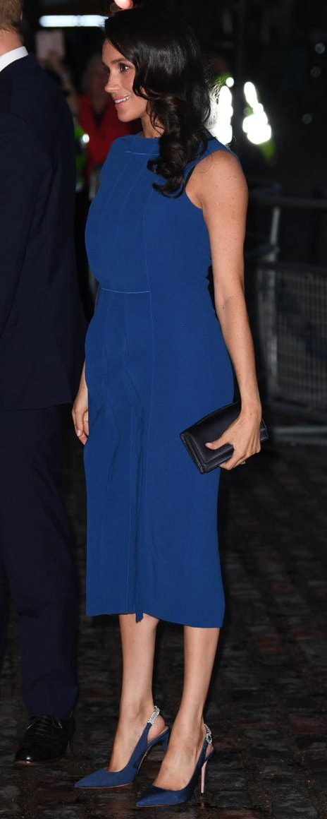 Dior Navy Satin Clutch Bag as seen on Meghan Markle, the Duchess of Sussex at 100 Days to Peace concert gala
