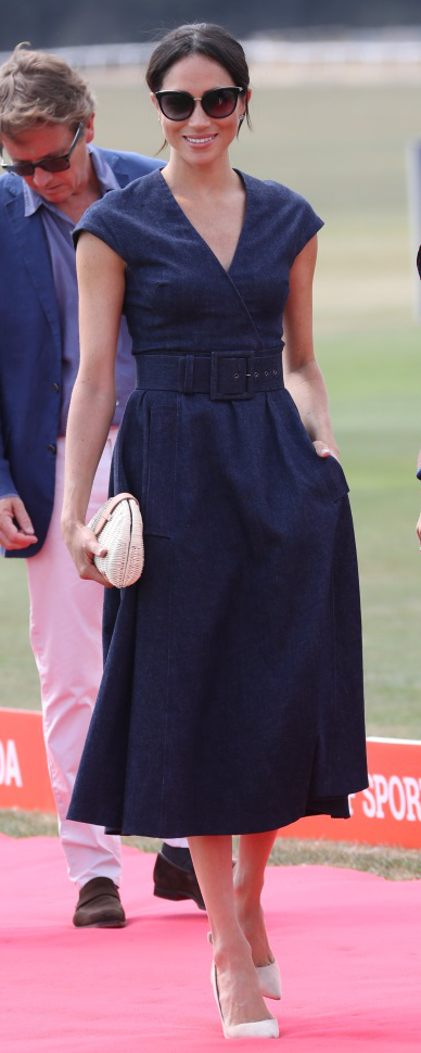 Carolina Herrera V-Neck Faux Wrap Denim Midi Dress as seen on Meghan Markle, the Duchess of Sussex at Sentebale Polo Cup 2018