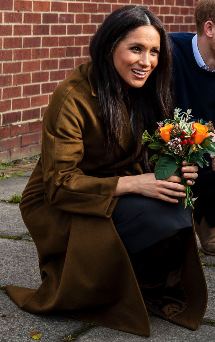 Duchess Meghan Markle wears Olive brown belted coat